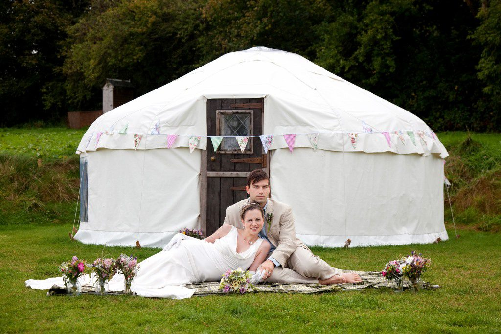 Bride and groom outside yurt